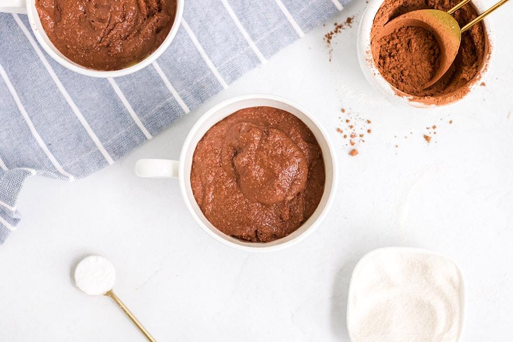 mug cake in a mug next to ingredients