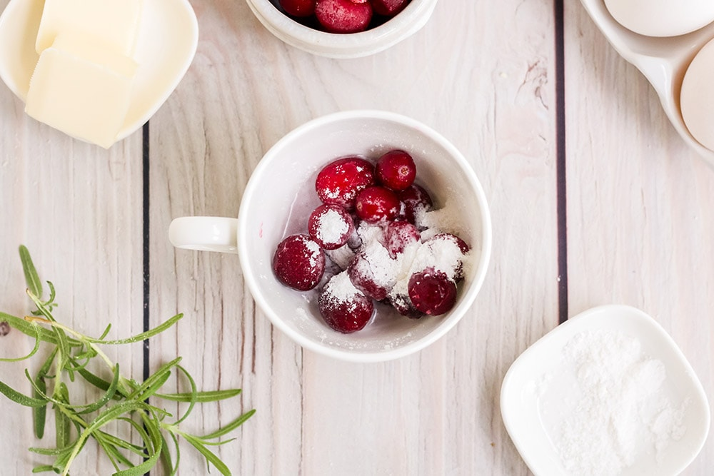 cranberries and sweetener in a mug
