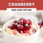 Cake in a mug topped with cranberries