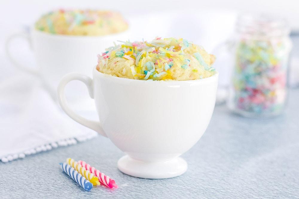 low carb funfetti mug cake next to candles