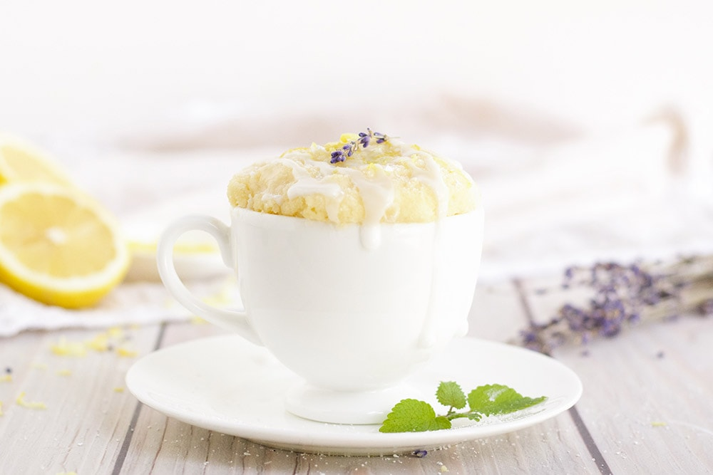 lemon cake in a white mug topped with lavender