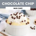 low-carb chocolate chip mug cake next to a gold fork and blue napkin