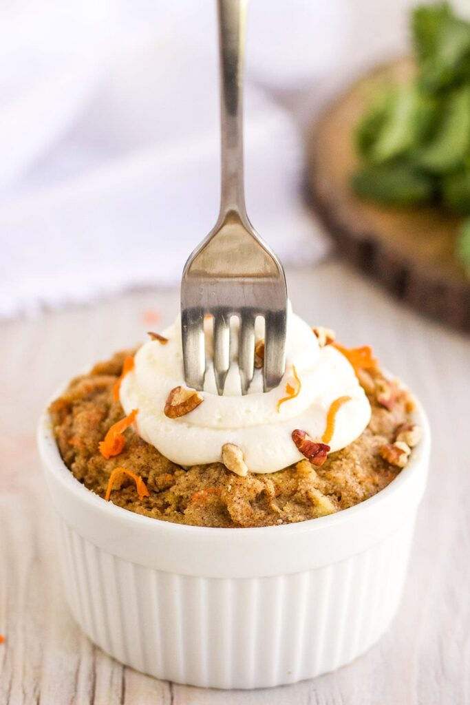 Fork stuck in a low-carb carrot mug cake
