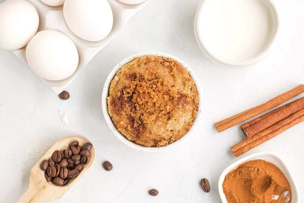 Overhead shot of cooked coffee cake in a mug
