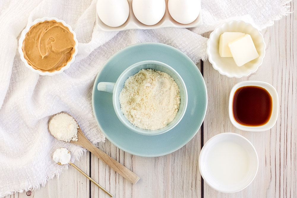 Peanut butter, eggs, and other ingredients for peanut butter mug cake.