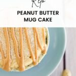 Peanut butter cake with peanut butter drizzles in a light blue mug.