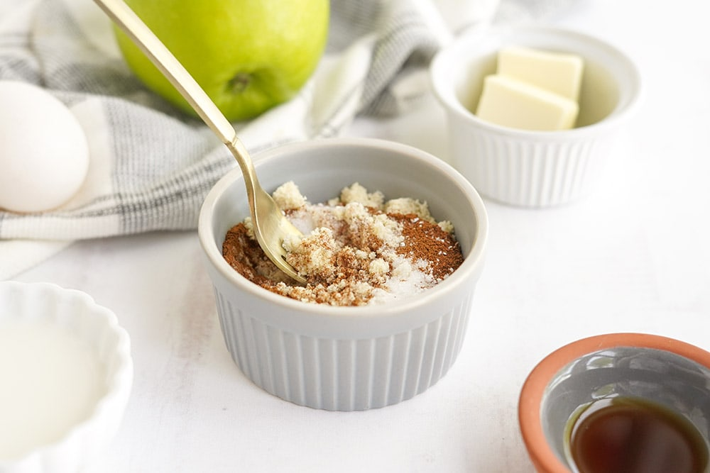 Dry ingredients in a ramekin with a fork.