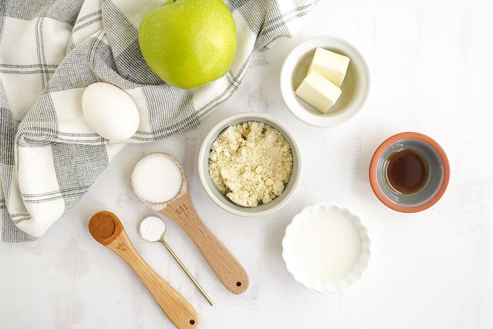Ingredients in bowls to make an apple mug cake.