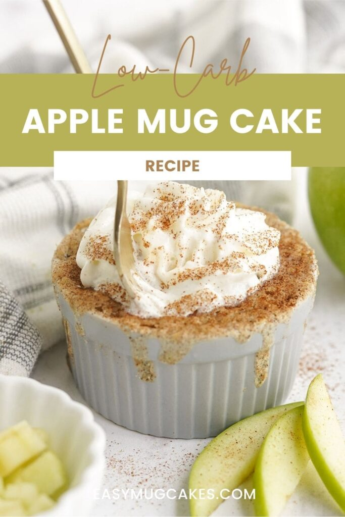 Apple mug cake topped with whipped cream and cinnamon.