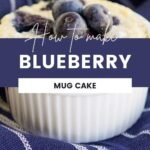 Mug cake topped with blueberries sitting on a blue and white napkin.