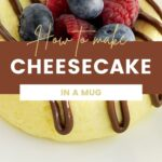 Cheesecake on a white plate topped with chocolate and berries.