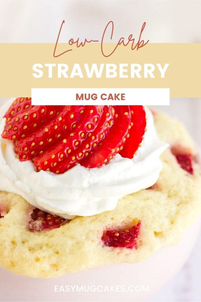 Close up of a strawberry mug cake with whipped cream.